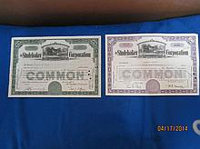 2 RARE STUDEBAKER CORP. STOCK CERTIFICATES - ONE GREEN HAND WRITTEN 1935 - ONE PURPLE 1954 WITH VIGNETTE OF THE FIRST STUDEBAKER SHOP - BOTH ONE WAY