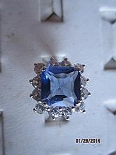 BEAUTIFUL STERLING SILVER DESIGNERS COCKTAIL RING FEATURING A LARGE TANZANITE COLORED CENTER SQUARE STONE SURROUNDED BY 12 ROUND CLEAR STONES SIZE 7 - IT IS A BEAUTY
