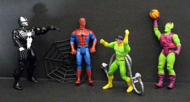 MARVEL - SPIDER-MAN & FOES - VINTAGE ACTION FIGURES - LOT OF FOUR - Toy Biz, 1991 – Includes Spider-Man with web, The Green Goblin, Doc Oc, and Venom. Each figure stands approximately 5