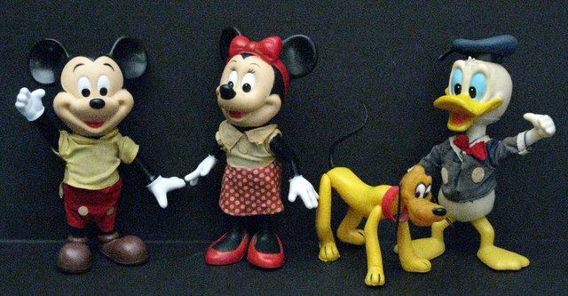 LOT OF FOUR VINTAGE DISNEY CARTOON CHARACTERS FROM DISNEYWORLD – 4 POSEABLE PVC FIGURES - Walt Disney Productions, 1976 - Lot includes Mickey Mouse, Minnie Mouse, Pluto, and Donald Duck. Fun tiny figures of Disney's most iconic characters. Each stands 7 1/2
