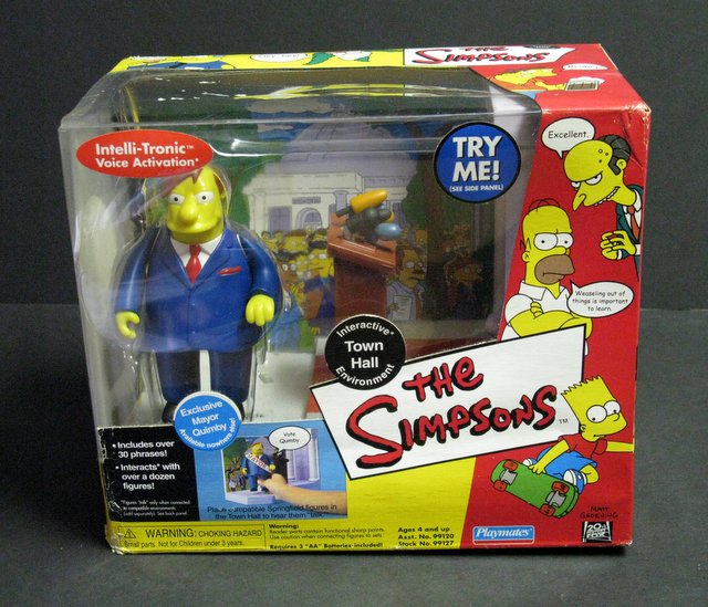 WORLD OF SIMPSONS - TOWN HALL ELECTRONIC ENVIRONMENT - Playmates, 2000 - Interactive playset allows figures to talk.Features exclusive figure of Mayor Quinby. Brand new in sealed box.