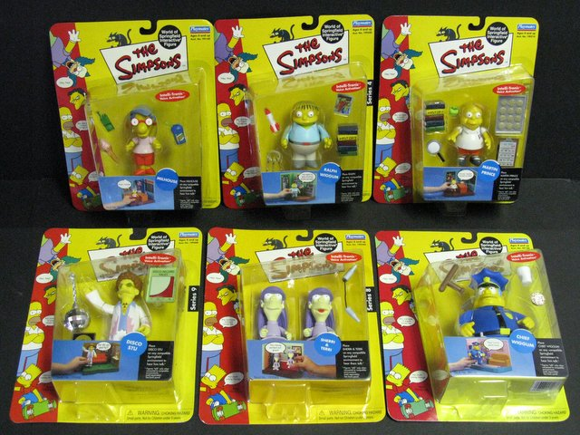WORLD OF SIMPSONS - SET OF SIX ACTION FIGURES - Playmates, 2001 - 2004 - Set includes Chief Wiggum, Ralph Wiggum, Millhouse, Martin Prince, sassSherri & Terri, and Disco Stu. All figures include interactive voice chip and accessories. All new on sealed cards.