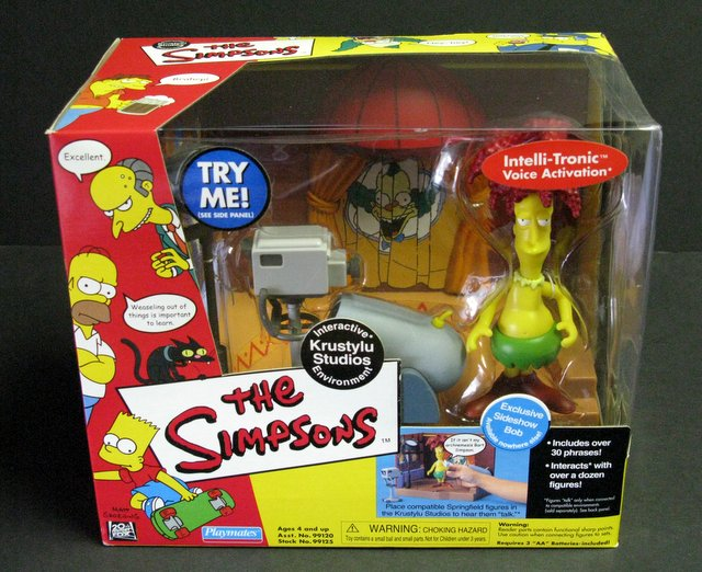 WORLD OF SIMPSONS - KRUSTYLU STUDIOS ELECTRONIC ENVIRONMENT - Playmates, 2000 - Interactive playset allows figures to talk.Features exclusive figure of Sideshow Bob. Brand new in sealed box.