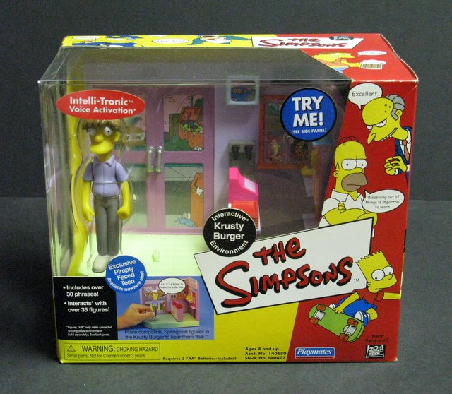 WORLD OF SIMPSONS - KRUSTY BURGER ELECTRONIC ENVIRONMENT - Playmates, 2001 - Interactive playset allows figures to talk. Features exclusive figure of Pimply Faced Teen. Brand new in sealed box.