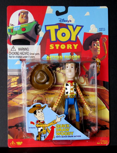 "DISMEY'S TOY STORY - WOODY THE COWBOY - 7"" ACTION FIGURE - Thinkway Toys, 1995 - Rare original issue of 'Quick Draw Woody. Sealed on card."