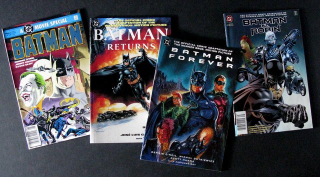 TIM BURTON'S BATMAN & SEQUELS - 4 FILM COMIC BOOK ADAPTATIONS - DC Comics, 1989-1997 - Complete set of four deluxe full color comics narrating batman's adventures through his four movies. Excellent.
