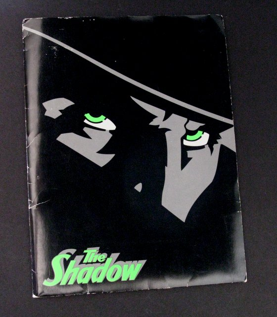 THE SHADOW - PRESS KIT - Fantastic press kit of the brilliance that is The Shadow. Includes color pictures, newspaper articles, artwork, a plot synopsis, cast, crew, and various behind the scenes information. Excellent.