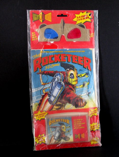 DISNEY'S THE ROCKETEER – MOVIE 3D COMIC GLASSES & AUDIO TAPE - Walt Disney Company, 1991 - The famous Rocketeer in this deluxe 3D comic book of the film! With original glasses and audio tape to hear the adventure. Mint and sealed.