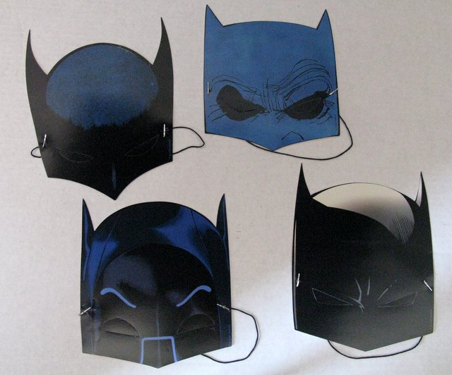 BATMAN THROUGH THE AGES - PAPER MASKS - LOT OF 4 CLASSIC BAT COWLS - DC Comics, 2010 - Each paper mask measures approximately 8