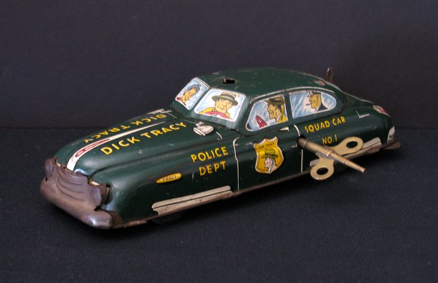 DICK TRACY WIND-UP SQUAD CAR TIN TOY – 1945 - Vintage wind-up toy car of the famous Dick Tracy Squad Car. Vehicle works well. It does not have its original key but the key with it works. Missing original siren up top. Overall Good for its age.