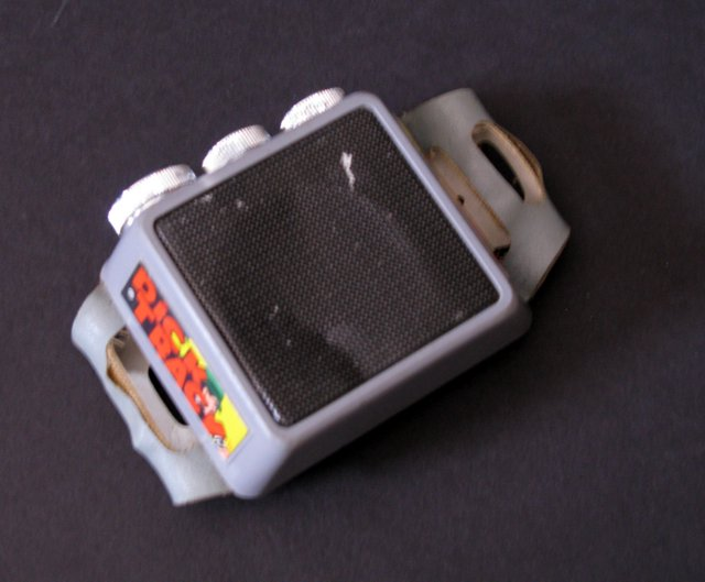 DICK TRACY WRIST COMMUNICATOR - Vanity Fair Industries, 1964 - Vintage communications device from the classic '60's TV cartoon era. Non-working with dent in top, but otherwise in Good condition.