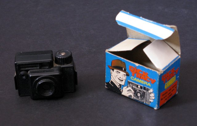 DICK TRACY VINTAGE MINI CAMERA - Laurie Import, 1975 – Rare vintage camera that actually takes ten 16mm black and white pictures on film. Excellent with original box.