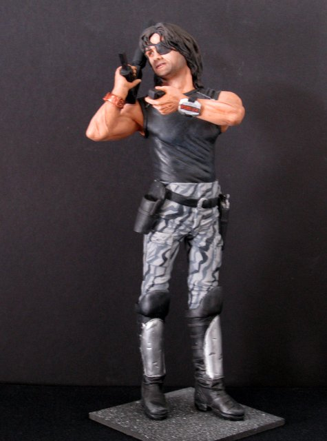 ESCAPE FROM NEW YORK – SNAKE PLISSKEN – RARE PAINTED RESIN MODEL – Flintstone Studios, 2005. – Magnificent sculpture of the antihero, powerfully painted, solid cast resin.