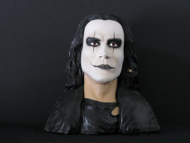 "THE CROW - RARE PAINTED RESIN BUST – Simian Productions, 1995 - Extremely rare, solid resin portrait of Brandon Lee as The Crow. Sculpted and painted by Barsom, signed and dated. Measures 7 ½"" tall x 7"" wide. One of 15 cast."