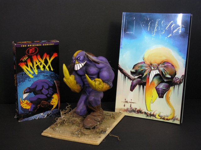MTV's THE MAXX COLLECTOR'S LOT –PAINTED MODEL, VHS MOVIE & GRAPHIC NOVEL - 1996 - The perfect lot for any Maxx fan. The painted resin model stands 8