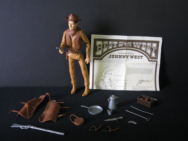 "VINTAGE JOHNNY WEST COWBOY ACTON FIGURE – Marx Toys, 1975 – 12"" tall poseable plastic Johnny West figure. Complete with multiple accessories and illustrated instructions. Loose right leg, otherwise Very Good."