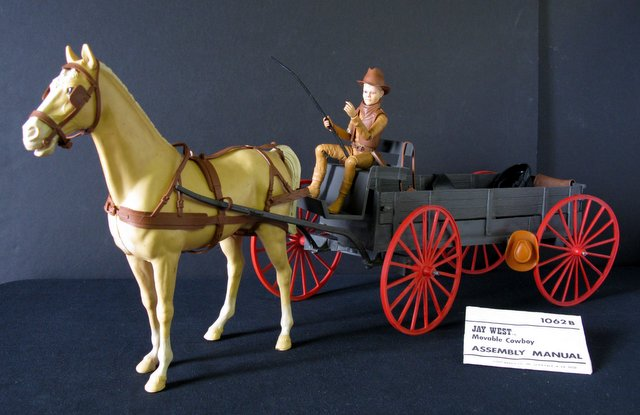 "VINTAGE JAY WEST, BUCKBOARD WAGON & HORSE JOHNNY WEST TOYS – Marx Toys, 1975 – Lot includes 9"" tall Jay west figure, multiple accessories, Jay West illustrated instruction sheet, buckboard wagon with rolling wheels, and rolling horse. Jay's arms are broken at the elbows and re-glued, otherwise Very Good. Wagon and horse Very Good."