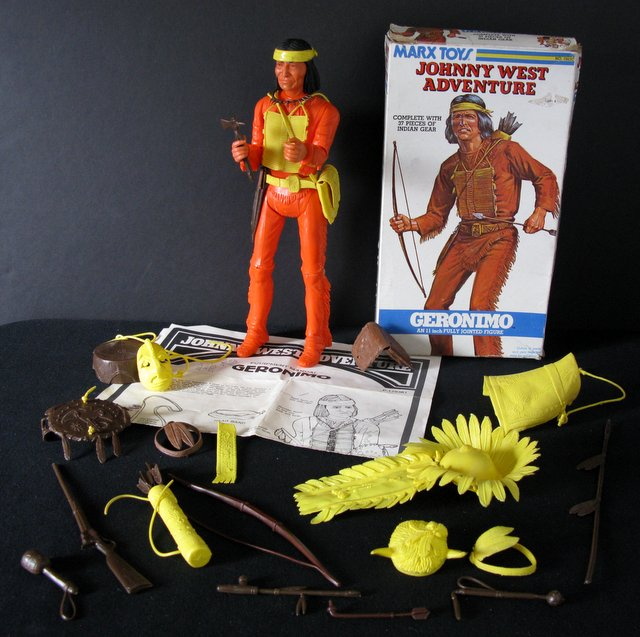 "VINTAGE GERONIMO JOHHNY WEST ACTION FIGURE – Marx Toys, 1975 – 11 1/2"" tall poseable plastic Geronimo figure. Complete with all accessories, illustrated instruction sheet, and original full-color box. Figure and accessories Excellent, box Good."