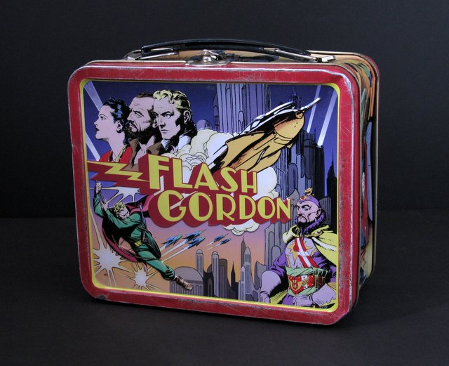 "RETRO FLASH GORDON METAL LUNCHBOX - Dark Horse, 2000 - Colorful tin lunch box of the classic space hero. Measures 8"" wide x 7"" tall. Good."