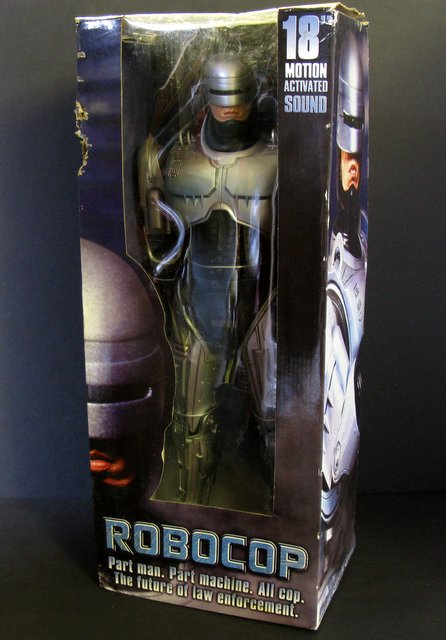"ROBOCOP 18"" TALKING FIGURE - NECA, 2005 - Deluxe poseable Robocop figure with motion activated sound featuring phrases from the film. Includes gun. Box a bit rough, figure Mint and sealed inside."