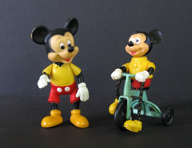 DISNEY'S MICKEY MOUSE VINTAGE FIGURE LOT OF TWO - Walt Disney Productions, 1976 - Lot features one standing Mickey and one riding a tricycle! Standing Mickey measures 6