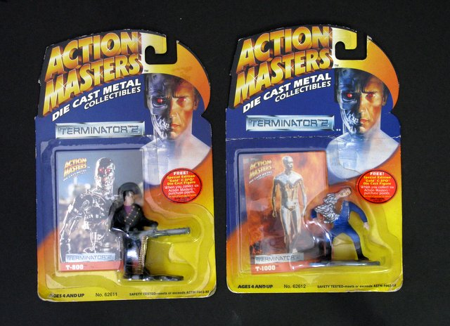 TERMINATOR 2 - DIE-CAST METAL COLLECTIBLES LOT OF 2 - Carolco Pictures, 1994 - Deluxe mini metal figurines. Lot includes T-800 and battle damaged T-1000. Each comes with collector's card. Sealed on card.