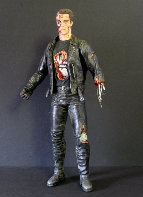 "TERMINATOR 2 - ARNOLD T-800 - PAINTED MODEL FIGURE – Horizon Hobbies, 1991 - Pro-painted 13"" model featuring a battle damaged Arnold as the Terminator. Excellent."