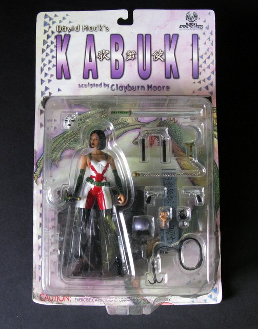 "DAVID MACK'S KABUKI ACTION FIGURE Moore Action Collectibles, 2000 – Exciting 6"" female warrior action figure featuring many accessories, weapons, and interchangeable hands. New on sealed card."