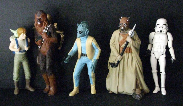"STAR WARS HEROES & VILLAINS - VINTAGE PVC FIGURE LOT OF FIVE - Applause, 1995 - Lot features Endor Luke with Yoda strapped to back, Chewbacca with C-3P0 strapped to back, Storm Trooper Han Solo with removable helmet, Tusken Raider, and Greedo. All stand approx. 10"" tall, all Very Good."