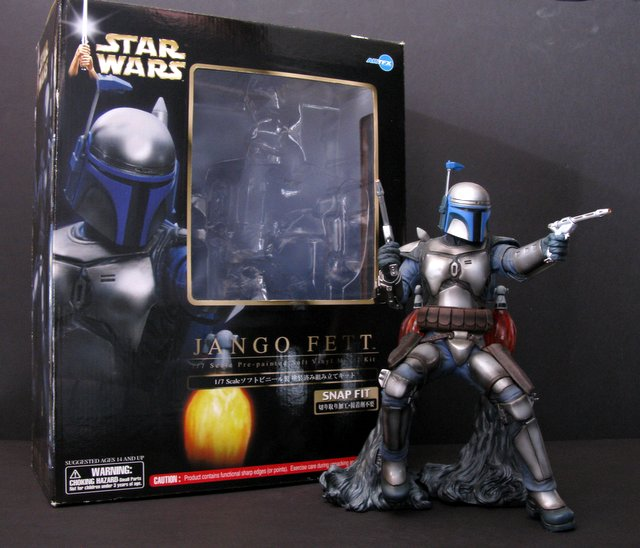 "STAR WARS - JANGO FETT - RARE PAINTED FIGURE – Dark Horse Comics, 2002 – Deluxe fully assembled statue featuring the infamous bounty hunter blasting off. Includes translucent flames under jetpack and twin pistols. Stands 11 ½"" tall. Statue Near Mint. Box Excellent."