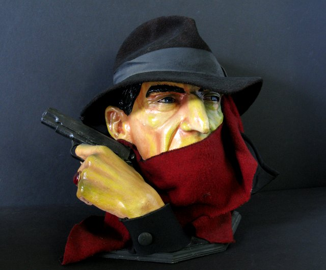 "THE SHADOW LIFESIZE BUST – Incredible one-of-a-kind sculpture of the famous pulp hero. Measures 14"" tall x 13"" wide. Includes hat, scarf, gun, and Shadow ring. Excellent."