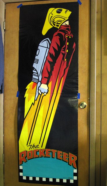 """DISNEY'S THE ROCKETEER - 6 FOOT TALL DOOR POSTER - Starmakers, 1991 - Striking jumbo poster measures 25"""" x 72"""". One central fold, otherwise Excellent."""
