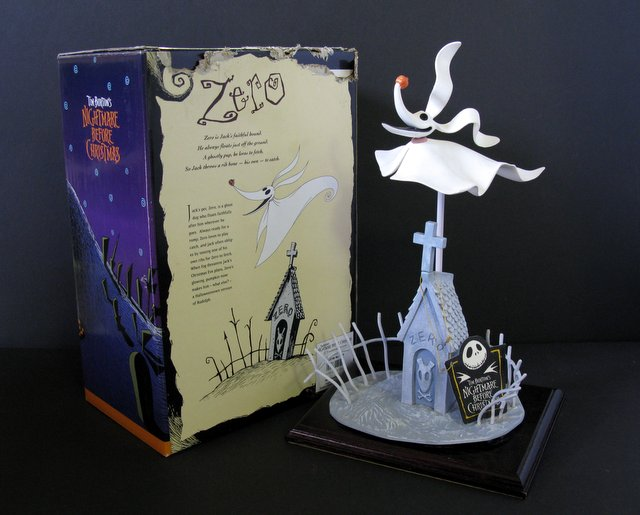 "ZERO - NIGHTMARE BEFORE CHRISTMAS ZERO - PAINTED STATUE - Jun Planning, 1995 - Beautiful statue of the ghostly mascot of the movie. Includes base with graveyard dog house, original colorful box, tag, and wooden base for structure. Piece stands 14"" tall. Statue Excellent, box rough on top."