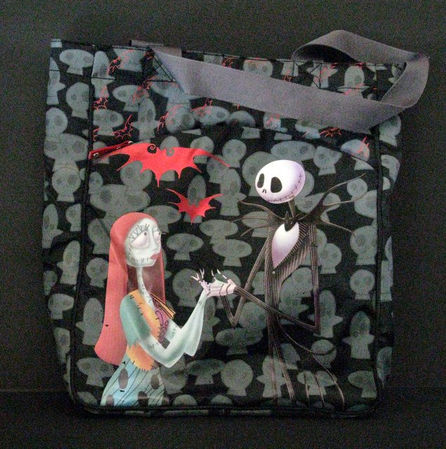 "NIGHTMARE BEFORE CHRISTMAS - TOTE-BAG - Loungefly, 1996 - Beautiful illustrations of the famous couple, Jack and Sally. Measures 10 ½"" x 13 ½"". Includes zipper sealed compartment on the front. Lightly used, Very Good."