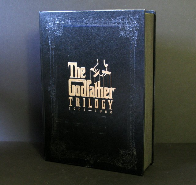 "THE GODFATHER TRILOGY SPECIAL VHS BOXED EDITION - Paramount Pictures, 1992 - Collector's Edition VHS set of The Godfather Trilogy on five tapes and a behind-the-scenes look through a sixth tape. Also includes lavish full-color booklet of information and photos on the Trilogy. Book-shaped box measures 9 ½"" wide x 13"" tall. Like new, most tapes still sealed."