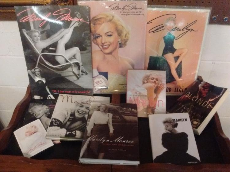LARGE MARILYN MONROE LOT TO INC. 3 METAL SIGNS & MULTIPLE HARDCOVER & PAPERBACK BOOKS