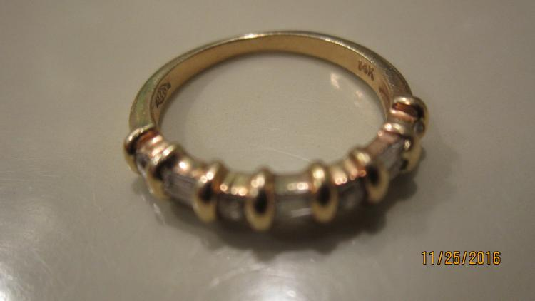 UNUSUAL 14 K YELLOW GOLD RING WITH 6 DIAMOND BAGUETTES AND 4 ROUNDS - SIZE APPROX. 6.5 - EXC. COND