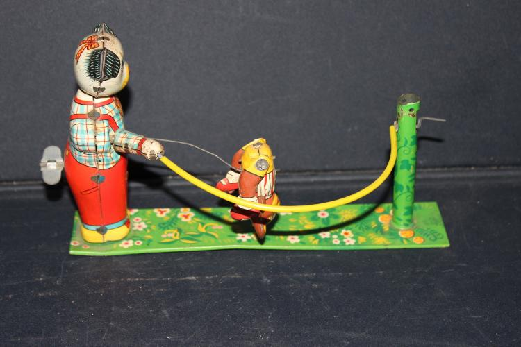 OLD TIN WINDUP TOY - NO MAKERS NAME - WINDUP JUMP ROPE WORKS FINE - NO BREAKS OR BENDS