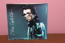 ELVIS COSTELLO – COLUMBIA MUSIC 4 SONGS- 2 PER SIDE – NEAR MINT-SUPER SLEEVE