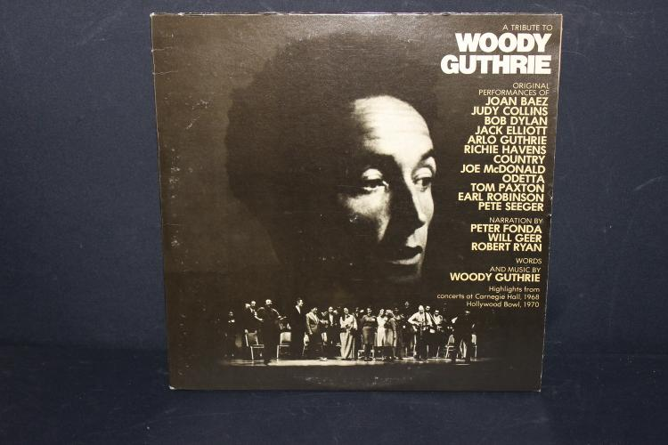 A TRIBUTE TO WOODY GUTHRIE WITH A LONG LIST OF WELL KNOWN PERFORMERS 2 RECORD SET NEAR MINT GATEFOLD