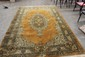 THIS IS A BEAUTIFUL RUG BUT HAS MINOR DAMAGE ON ONE BORDER - 115 X 79