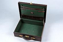 A LEATHER BRIEF CASE with green leather cloth and