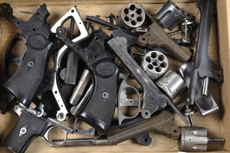 A GROUP OF WEBLEY PISTOL PARTS comprising: various frames, barrels, etc, so