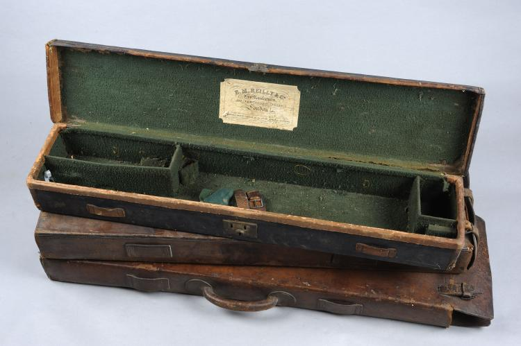 E. M. REILLY A CANVAS GUN CASE with compartment for 30-inch barrels; togeth