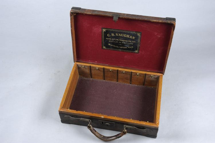 C. B. VAUGHAN A BRASSBOUND OAK AND LEATHER CARTRIDGE MAGAZINE for about 350