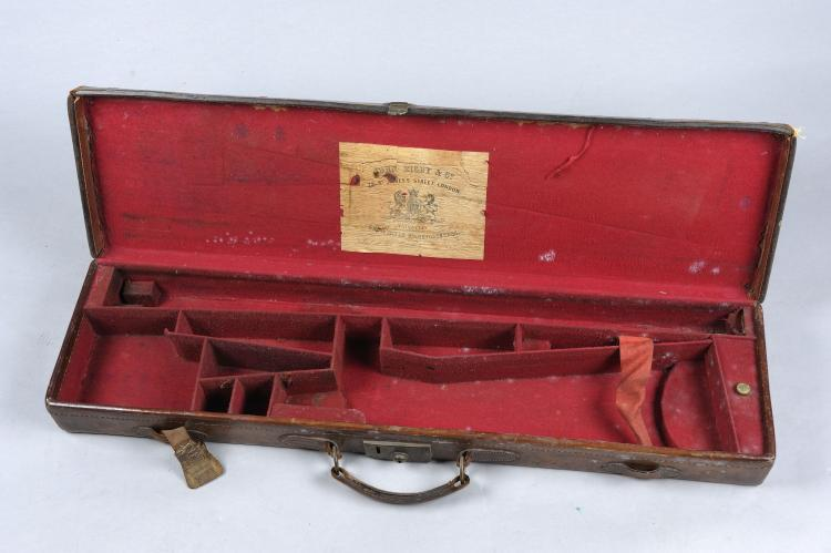 JOHN RIGBY & CO. A LEATHER GUN CASE suitable for a hammer gun, with compart