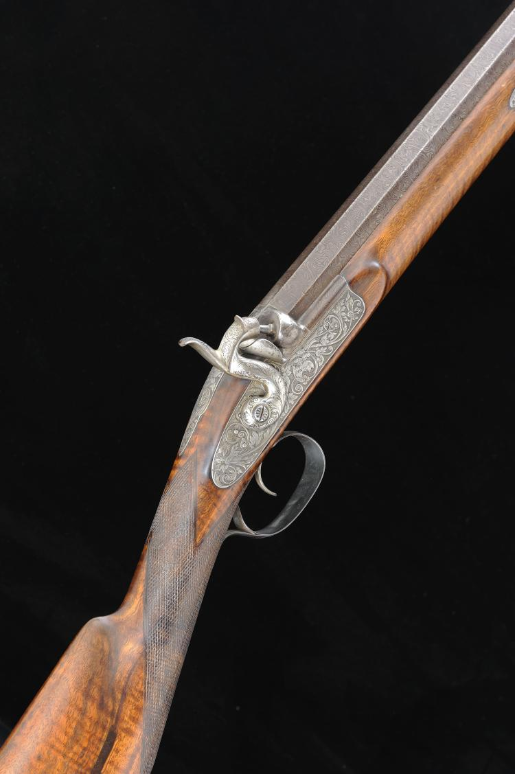 A SINGLE BARREL 8-BORE PERCUSSION GUN 39 1/2-inch two-stage octagonal to ro