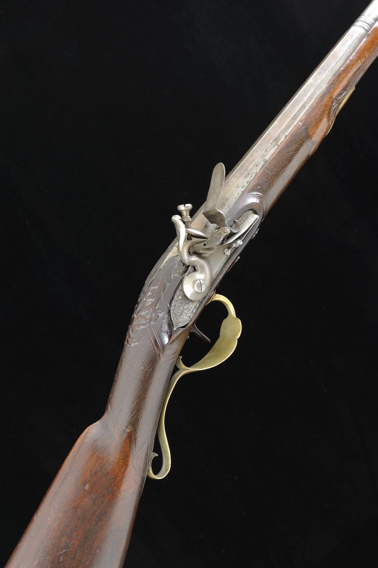 A CONTINENTAL 20-BORE FLINTLOCK SPORTING GUN 31 1/2-inch two-stage octagona