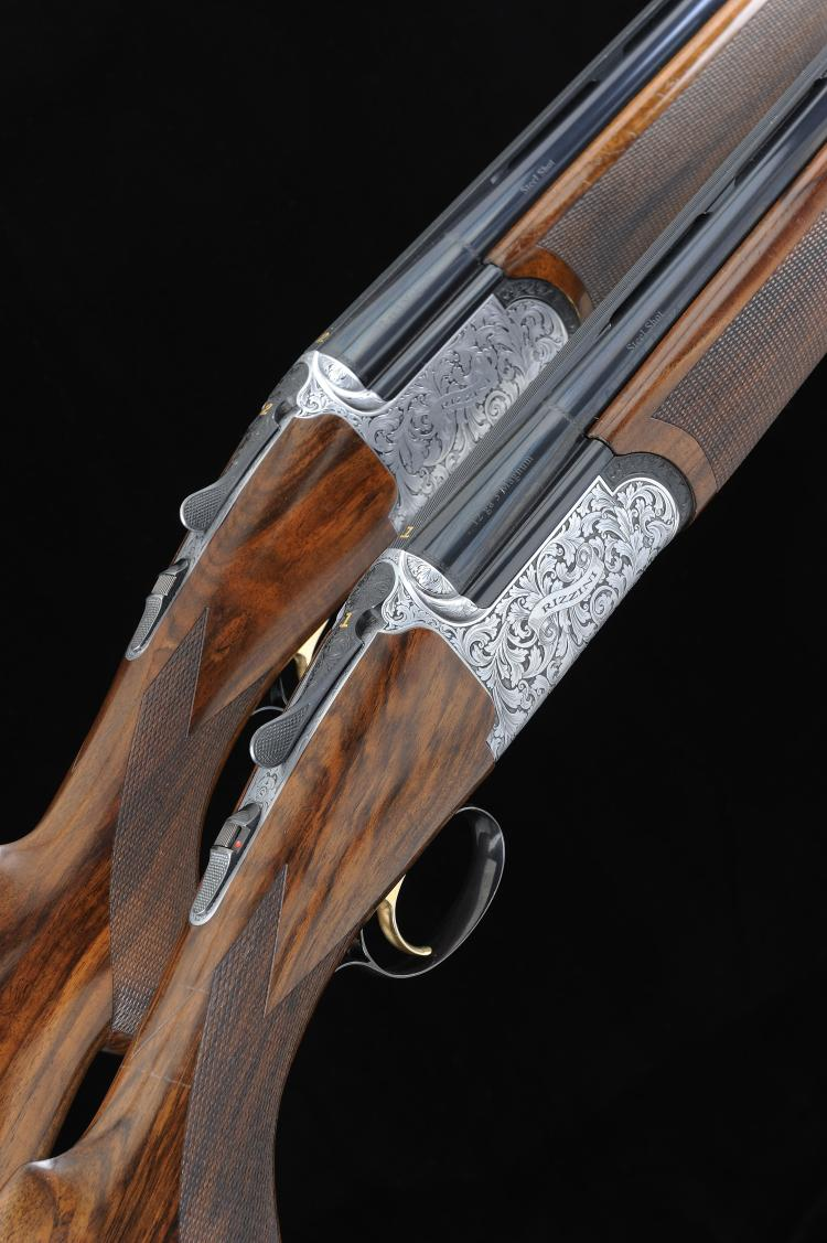 RIZZINI A PAIR OF 12-BORE ROUND BODY SINGLE TRIGGER OVER AND UNDER EJECTOR