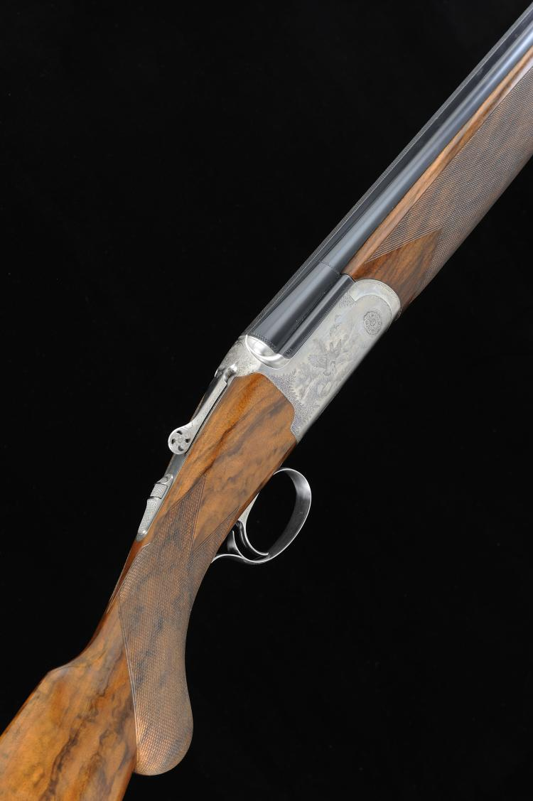LAURA BOSIS A 20-BORE SINGLE TRIGGER ROUND BODY OVER AND UNDER EJECTOR GUN,